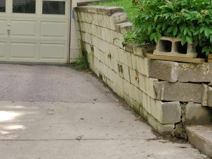 a failing retaining wall around a driveway in Bedford
